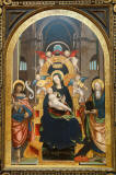 Defendente_Ferrari-Enthroned_Madonna_and_Child_with_Saints_John_the_Baptist_and_John_the_Evangelist-by_1525-oil_on_wood_panel-Chazen_Museum_of_Art